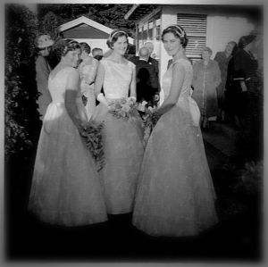 Carol (right) as a bridesmaid